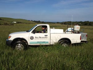 All Seasons Weed Control - truck in the field