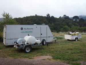 All Seasons Weed Control euqipment trailer and weed control quipment on the job site